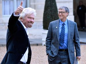 PARIS, FRANCE - DECEMBER 12: Bill Gates (R) and Richard Branson leave after a meeting with French President Emmanuel Macron as he receives the One Planet Summit's international philanthropists at Elysee Palace on December 12, 2017 in Paris, France. Macron is hosting the One Climat Summit, which gathers world leaders, philantropists and other committed private individuals to discuss climate change. (Photo by )
