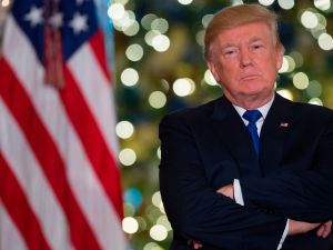 US President Donald Trump speaks about the tax reform legislation in the Grand Foyer of the White House in Washington, DC, December 13, 2017. / AFP PHOTO / SAUL LOEB (Photo credit should read SAUL LOEB/AFP/Getty Images)