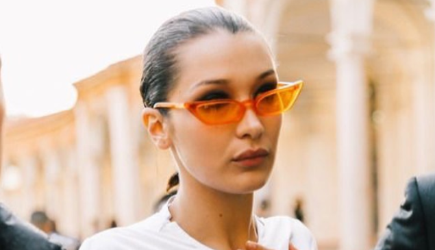 Bella Haddid in a pair of glasses by Poppy Lissiman.