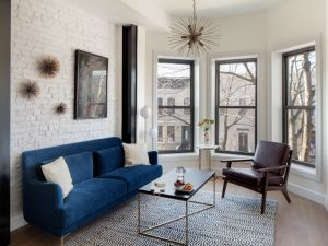 The co-living spaces at Node are decorated with a mix of West Elm and antique pieces.