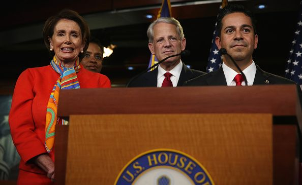 House Minority Leader Rep. Nancy Pelosi, left; Rep. Ben Ray Luján (D-N.M.), right; and other lawmakers listen during a news conference to announce new members of the House Democratic leadership team on Nov. 17, 2014 in Washington, DC.