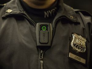 NYPD Officer Joshua Jones demonstrates how to use and operate a body camera during a press conference on Dec. 3, 2014 in New York City.