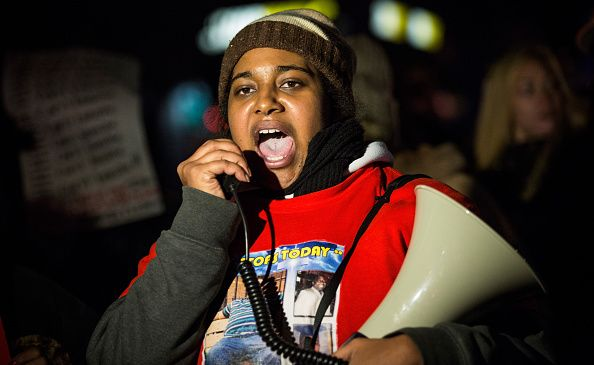 Erica Garner, daughter of Eric Garner, leads a march of people protesting a grand jury's decision not to indict a police officer involved in the chokehold death of her father in July on Dec. 11, 2014 on Staten Island.