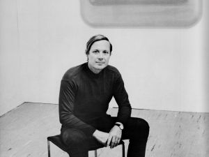 Craig Kauffman portrait with Untitled Wall Reliefs, 1967.
