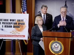 Senate Minority Leader Charles Schumer, center, speaks at a press conference urging Senate Republicans to support the passage of emergency funding to tackle the opioid and heroin crisis.