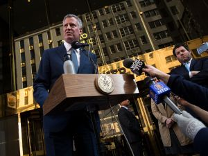 Mayor Bill de Blasio speaks to the press in front of Trump Tower after his meeting with President-elect Donald Trump on Nov. 16, 2016 in New York City.