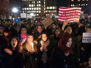 Demonstrators hold placards and candles as they gather during a Council on American-Islamic Relations news conference in New York City on Jan. 25, 2017.
