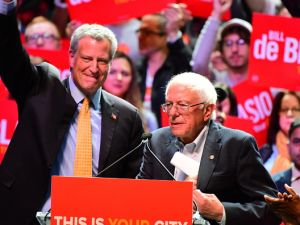 Mayor Bill de Blasio and Sen. Bernie Sanders (I-Vt.) speak at a campaign rally for de Blasio on Manhattan's West Side on Oct. 30, 2017.