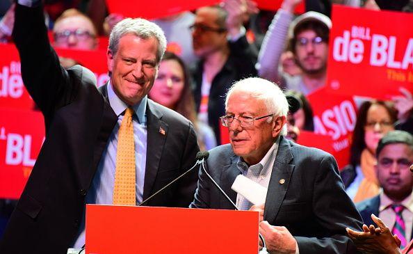 Mayor Bill de Blasio and Sen. Bernie Sanders (I-Vt.) speak at a campaign rally for de Blasio on Manhattan's West Side on Oct. 30, 2017.