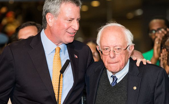 Mayor Bill de Blasio, left, and Sen. Bernie Sanders (I-Vt.), right, at a rally in support of the mayor's millionaire tax proposal.