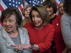 Rep. Nita Lowey (D-N.Y.), left; and House Minority Leader Nancy Pelosi, center; MomsRising; and other members conduct a news conference in the Capitol on Dec. 6, 2017 about President Donald Trump's tax plan. (Photo By Tom Williams/CQ Roll Call)