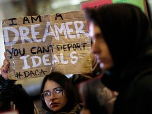 "Activists rally for the passage of a ""clean"" DREAM Act, one without additional security or enforcement measures, outside the New York office of Senate Minority Leader Charles Schumer on Jan. 10, 2018 in New York City. (Photo by Drew Angerer/Getty Images)"