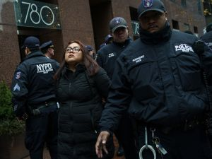 After blocking the doors to the building, an activist is arrested by the NYPD during a rally for the passage of a 'clean' Dream Act outside Senate Minority Leader Charles Schumer's New York City Office on Jan. 17, 2018.