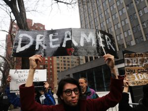 Demonstrators, many of them recent immigrants to America, protest the government shutdown and the lack of a deal on DACA outside of Federal Plaza on Jan. 22, 2018 in New York City. (Photo by Spencer Platt/Getty Images)