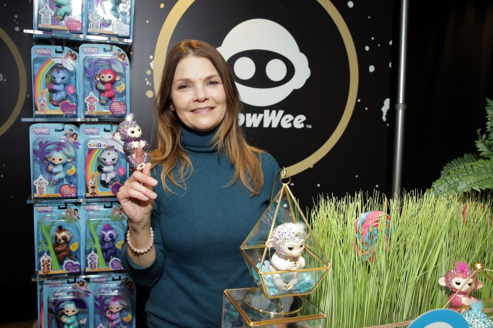 Law & Order actress Kathryn Erbe showing off a custom WowWee Fingerling.