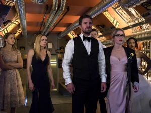 Melissa Benoist as Kara, Caity Lotz as Sara Lance, Stephen Amell as Oliver Queen, Grant Gustin as Barry Allen, Emily Bett Rickards as Felicity Smoak, and Candice Patton as Iris West on Arrow.