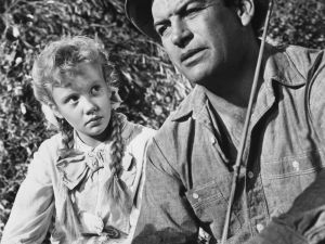 Hayley Mills as Pollyanna alongside Richard Egan (1923-1987) as Dr Edmond Chilton in Pollyanna, in 1960.