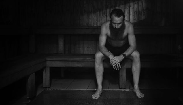 HASTINGS, AUSTRALIA - SEPTEMBER 18: (EDITORS NOTE: Image has been converted to black and white.) Jack Johnson of the Magpies does a recovery session in a sauna at Jubilee Park during the week in the lead up to the Nepean Football Netball League Grand Final match between the Crib Point Magpies and the Sorrento Sharks at Thomas Barclay Oval on September 18, 2014 in Hastings, Australia. Johnson was dropped from the team a day later at team selection and made emergency. (Photo by )