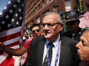 Former Maricopa County Sheriff Joe Arpaio is surrounded by protesters and members of the media at the Republican National Convention on July 19, 2016.
