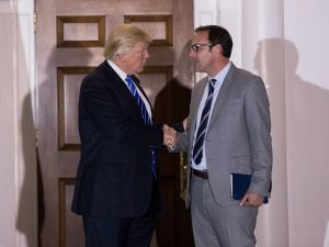 President Donald Trump shakes hands with Todd Ricketts.