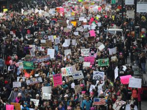 Thousands of people march on 42nd street during the Women's March.