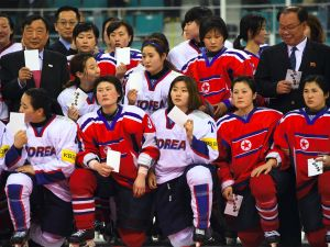 Players from South Korea (white) and North Korea (red) after the IIHF women's world ice hockey championships in Gangneung on April 6, 2017.