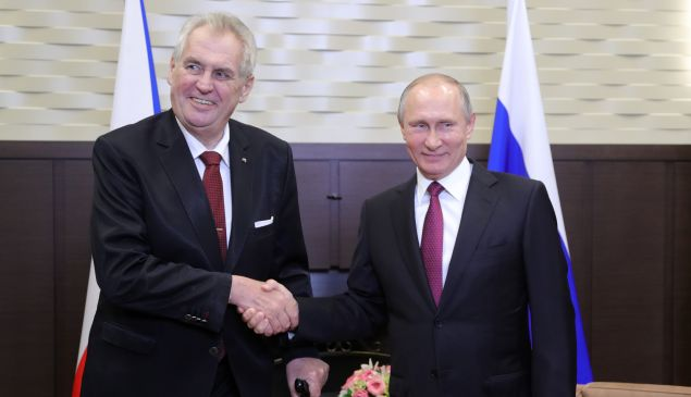 Russian President Vladimir Putin shakes hands with Czech President Milos Zeman during a meeting in Sochi on November 21, 2017.