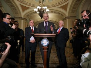 Senate Minority Leader Charles Schumer (D-NY) (C) is joined by Senate Minority Whip Dick Durbin (D-IL) (L) and Sen. Ben Cardin (D-MD) while talking to reporters.