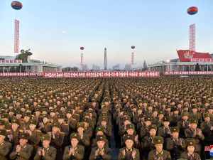 This picture released by North Korea's official Korean Central News Agency shows North Korean soldiers and Pyongyang residents holding a rally to celebrate the North's declaration on November 29, 2017 that it had achieved full nuclear statehood.