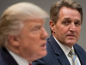 President Donald Trump next to Senator Jeff Flake.