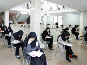 Iranian high school students sit for their university entrance examination in Tehran.