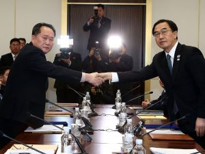 South Korean Unification Minister Cho Myoung-Gyon (R) shakes hands with the head of the North Korean delegation Ri Son-Gwon (L) after their meeting at Panmunjom in the Demilitarized Zone on January 9, 2018 in Panmunjom, South Korea.