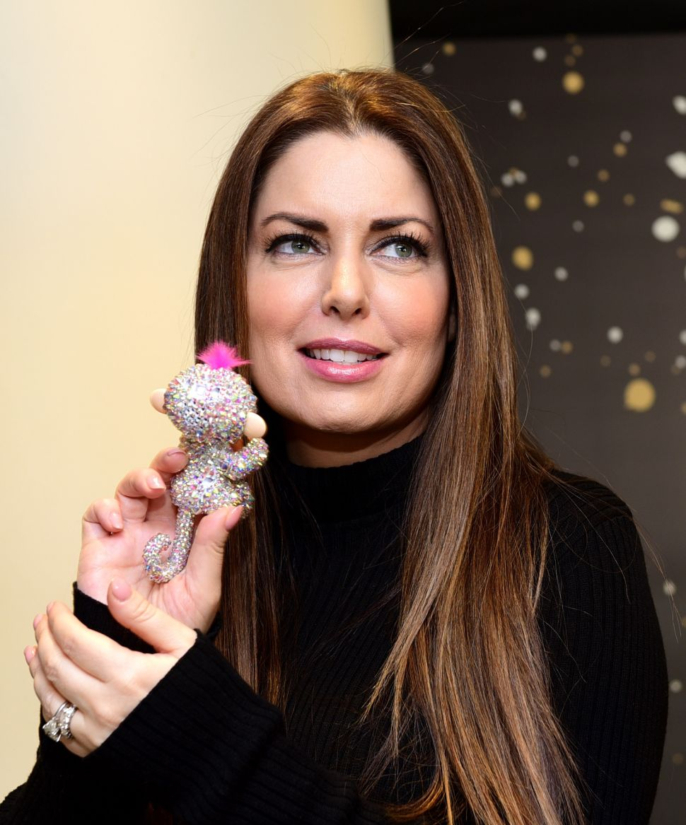 Stars, they're just like us! Only their Fingerlings are covered in rhinestones.