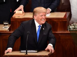 U.S. President Donald Trump smiles before the State of the Union address at the US Capitol in Washington, DC, on January 30, 2018.