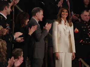 Melania stood out in her all-white threads.