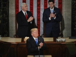 President Donald J. Trump delivers the State of the Union address as Vice President Mike Pence and Speaker of the House Rep. Paul Ryan look on in the chamber of the House of Representatives on January 30, 2018 in Washington, D.C.