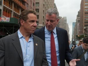 Mayor Bill de Blasio and Gov. Andrew Cuomo tour the site of the bomb blast on 23rd Street in Manhattan's Chelsea neighborhood on Sept. 18, 2016 in New York City.