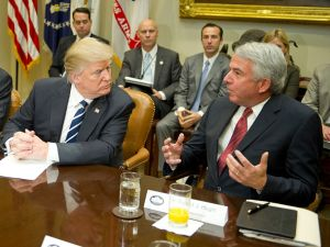 President Donald Trump listens to Bob Hugin, executive chairman of the Celgene Corp., during a meeting with representatives from the Pharmaceutical Research and Manufacturers of America at the White House on Jan. 31, 2017 in Washington, DC.
