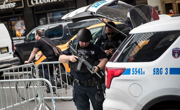 Members of the NYPD's counterterrorism squad prepare their weapons in Times Square on June 5, 2017 in New York City.