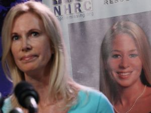 Beth Holloway with a photo of her daughter.