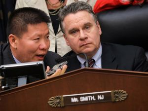 WASHINGTON, DC - MAY 15: U.S. Rep. Chris Smith (R-NJ) (R) and Chinese dissident and president of ChinaAid Bob Fu (L) listen to Chinese blind self-taught lawyer Chen Guangcheng on the phone during a hearing before the Global Health, and Human Rights Subcommittee of House Foreign Affairs Committee May 15, 2012 on Capitol Hill in Washington, DC. The subcommittee held a hearing to focus on the latest developments in Chen seeking to study in the U.S. after he escaped from his house detention and sought help in the U.S. Embassy in Beijing. (Photo by Alex Wong/Getty Images)