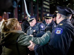 A woman gets arrested by NYPD.