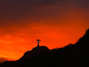 View of Christ the Reedemer during sunset at Copacabana beach in Rio de Janeiro, Brazil.