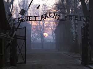 The entrance gate to the Nazi Auschwitz death camp at sunrise.