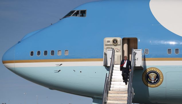 President Donald Trump walks down the stairs of Air Force One.