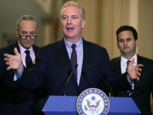 Sen. Chris Van Hollen (D-MD) (C), Senate Minority Leader Charles Schumer (D-NY) (L) and Sen. Brian Schatz (D-HI)