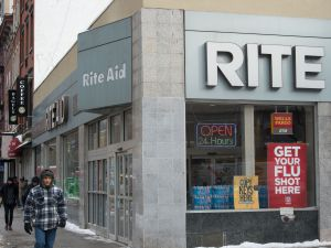 People walk past a Rite Aid store in Chelsea, New York on January 8, 2018 in New York.
