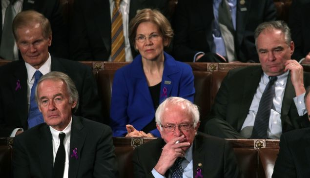 U.S. Sen. Bernie Sanders (I-VT) (C) watches during the State of the Union address in the chamber of the U.S. House of Representatives January 30, 2018 in Washington, DC. This is the first State of the Union address given by U.S. President Donald Trump and his second joint-session address to Congress. (Photo by