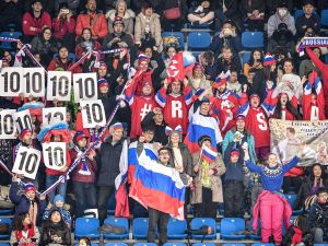 Spectators hold up placards in support of Russian figure skater Mikhail Kolyada during Pyeongchang 2018 on February 9, 2018.