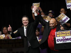 NEW YORK, NY - FEBRUARY 21: (L to R) New York Governor Andrew Cuomo and 1199SEIU United Healthcare Workers East President George Gresham gesture to the crowd at a healthcare union rally at the Theater at Madison Square Garden, February 21, 2018 in New York City. The rally was organized by 1199SEIU United Healthcare Workers East, the largest healthcare union in the United States. ()